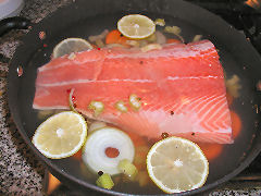 Salmon in court bouillon, ready to poach