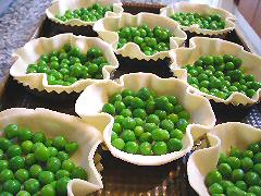 Fresh pea tarts ready to be filled