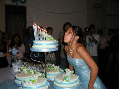 Blowing out the candles on the cake
