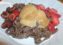 Chocolate fettucini with macerated fruit and dulce de leche