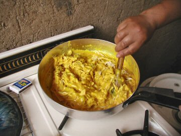 Maria making aji de gallina