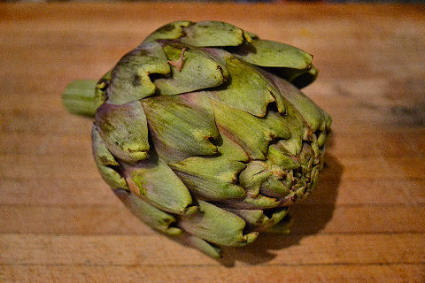 Artichoke on cutting board