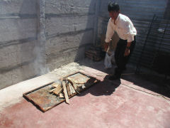 Miguel builds the fire for our asado
