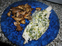 Cod with green onion sauce and sauteed mushrooms