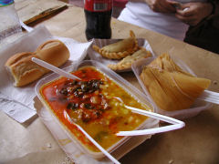 Locro, empanadas, and a tamale from a street stand