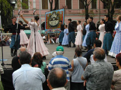 Dancers take to the stage during the Feria