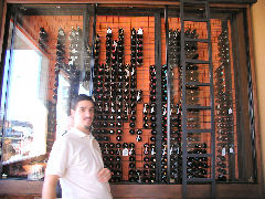 Minna - owner Fernando and his wall of wine