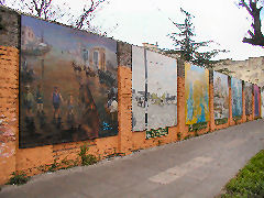Historic murals line the Sur Paredon