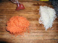Grate carrots and onion, equal quantities